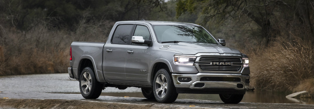 2019 Ram 1500 driving by a river