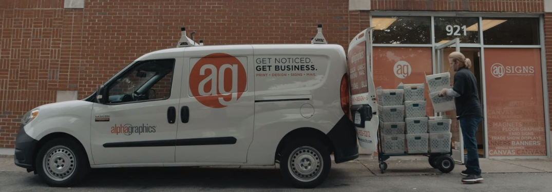 AlphaGraphics employee loading 2019 Ram ProMaster City van