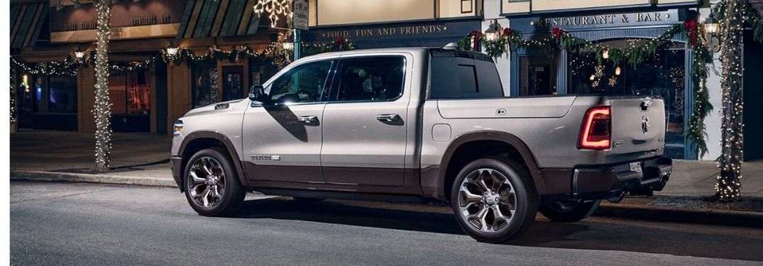 2020 Ram 1500 parked along store front with winter decorations