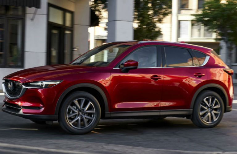 2017 Mazda CX-5 exterior view of left side in red