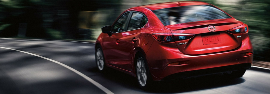 2018 soul red metallic mazda mazda3 rear view driving