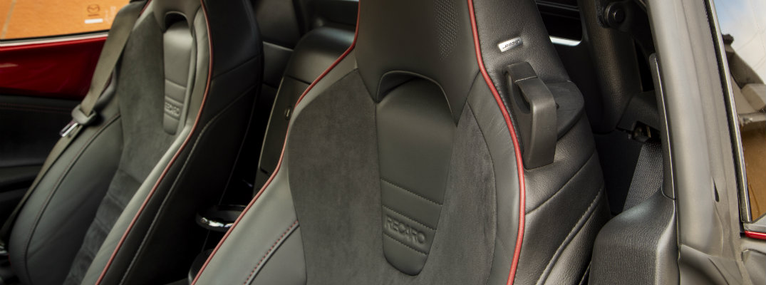 2019 Mazda MX-5 Miata interior shot of black cloth recaro seating with red accent stitching