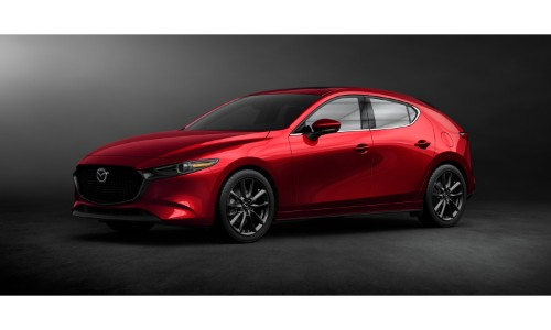 2019 Mazda3 Hatchback exterior shot with red paint color showing redesign in an empty showroom