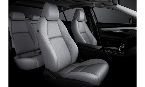 2019 Mazda3 interior shot of 2-row seating with white upholstery