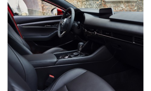 2019 Mazda3 interior shot of front seating upholstery, design organization, and dashboard accents and layout