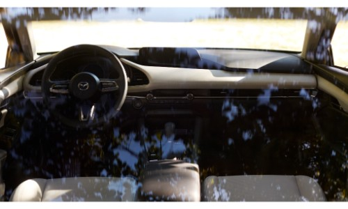 2019 Mazda3 interior shot of front seating view as shadows pass over the glass
