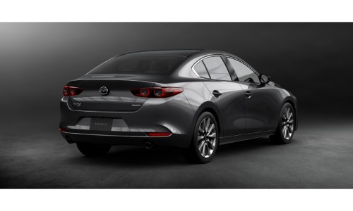 2019 Mazda3 sedan exterior rear shot with gray metallic paint color showing rear bumper and taillights design