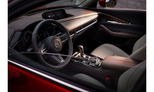 2020 Mazda CX-30 compact crossover SUV interior shot from driver's side window of ront seating and dashboard layout and design