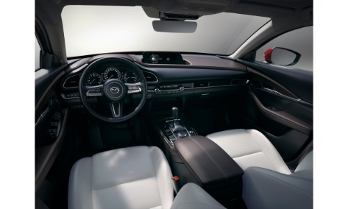 2020 Mazda CX-30 compact crossover SUV interior shot of front seating and dashboard design and layout