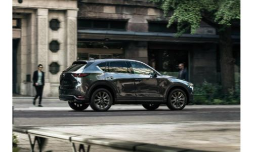 2019 Mazda CX-5 Signature SKYACTIV-D diesel model exterior side shot parked on the side of a city street