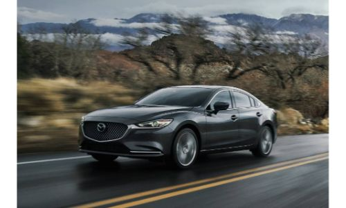 2019 Mazda6 Signature SKYACTIV-D diesel model exterior shot driving in the country