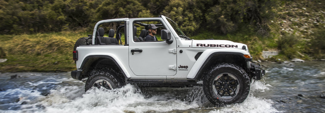 side view of a white 2018 jeep wrangler two-door water fording