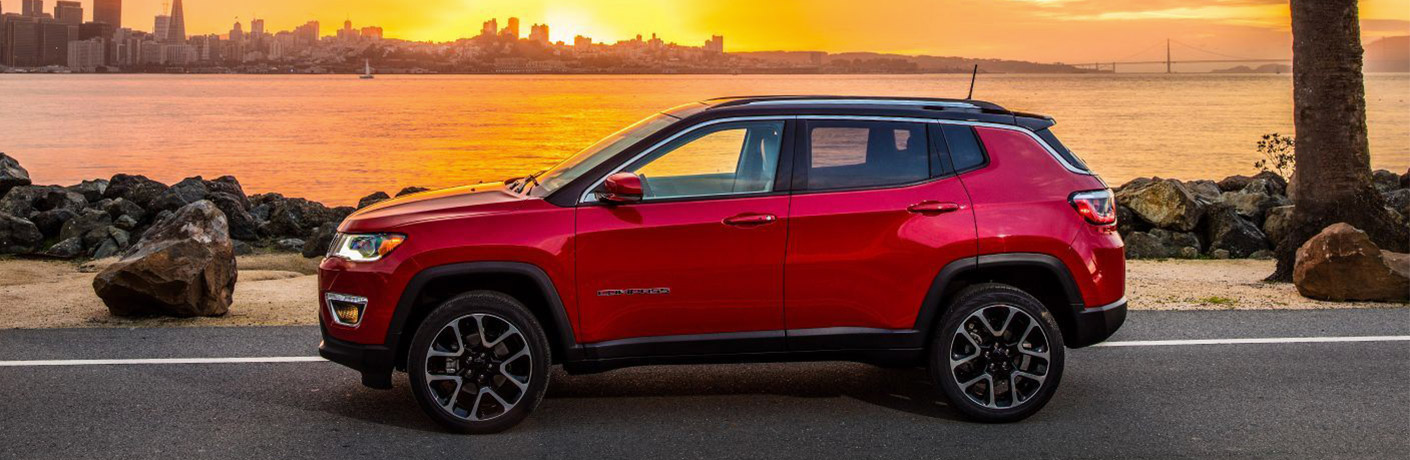 2019 Jeep Compass in red by sunset over water