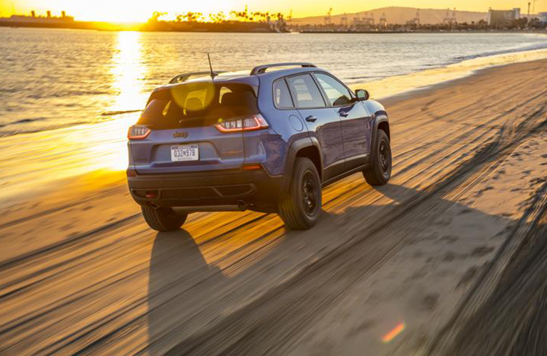 2020 Jeep Cherokee driving down beach