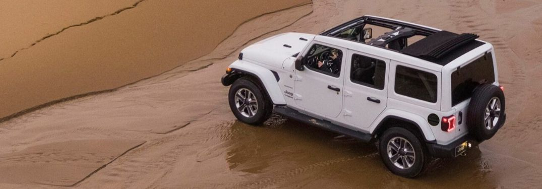 2020 Jeep Wrangler on beach with Sky One-Touch™ Power Top