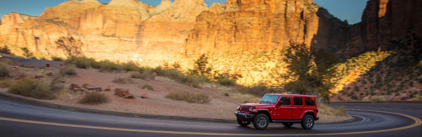 2021 Jeep Wrangler on road through scenic desert landscape