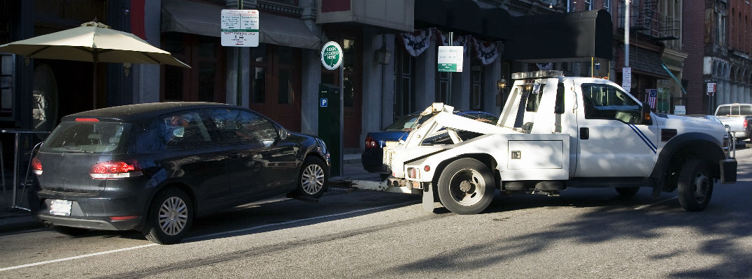 car getting towed by tow truck