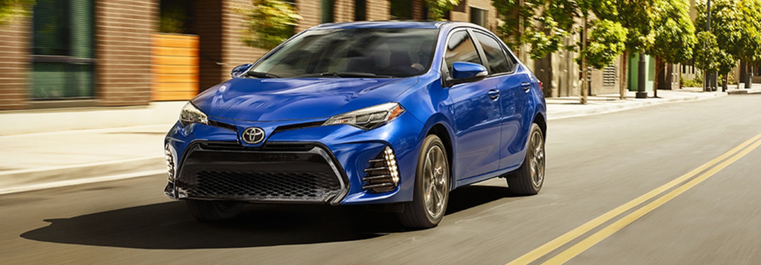 2018 Toyota Corolla in blue driving down the road