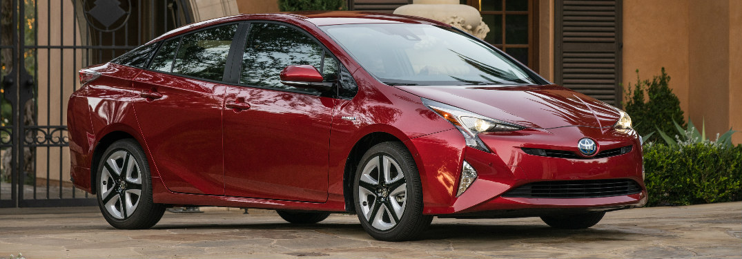 2017 Toyota Prius sitting in front of a grand home