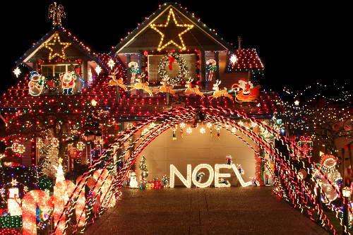 a house covered in holiday lights and decorations - Christmas Lights St Louis