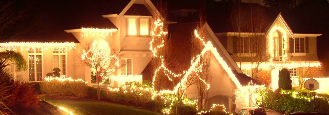 A house decked out in white Christmas lights