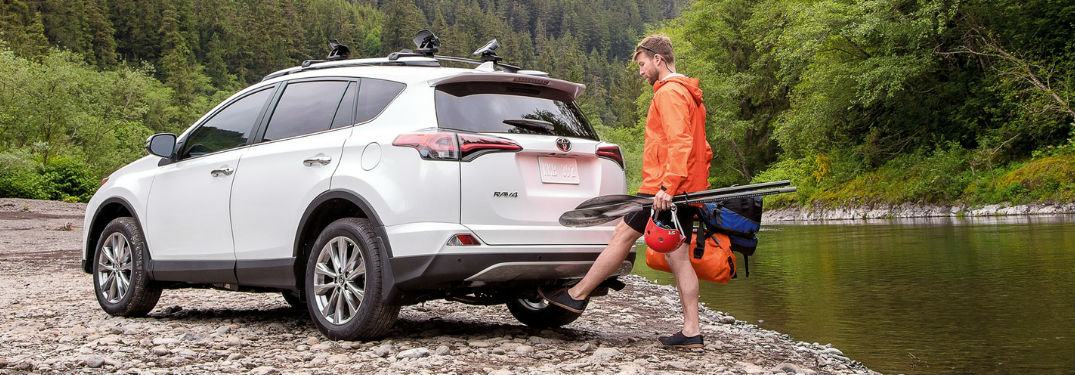 Driver of the 2018 Toyota RAV4 using the foot-activated power liftgate