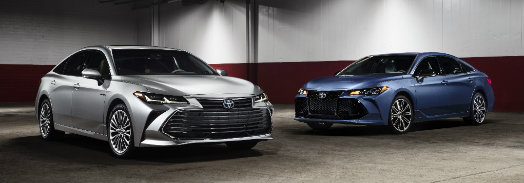 Two 2019 Toyota Avalon models parked in a warehouse