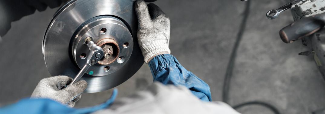 Mechanic working on brake parts