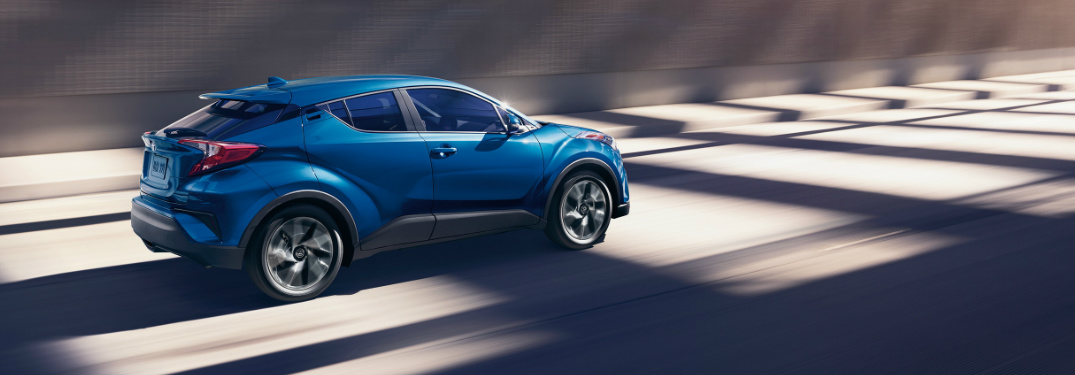 2019 Toyota C-HR in Blue Flame driving on an empty highway