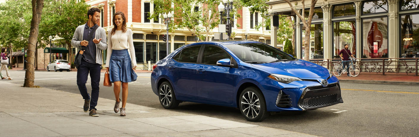 2019 Toyota Corolla in blue parked on the side of a city street