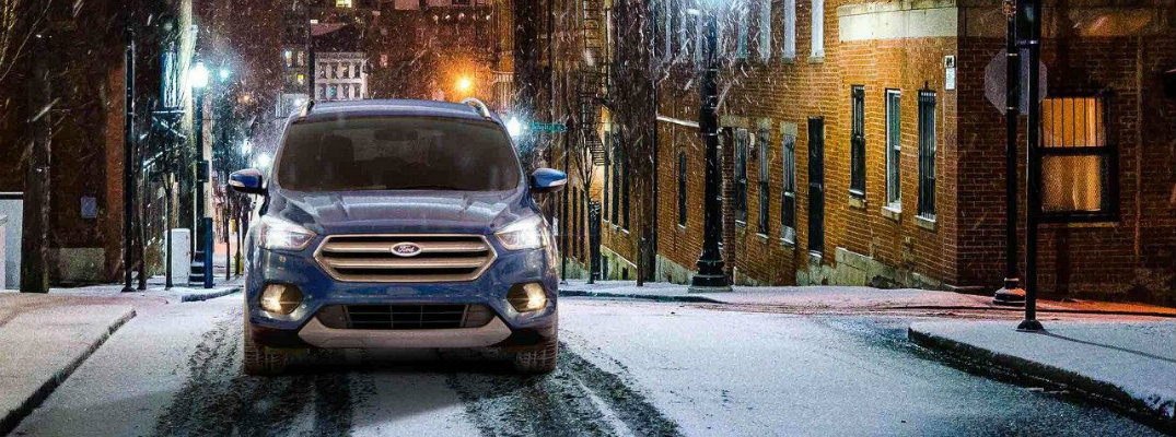 2018 Ford Escape driving up snowy path at night