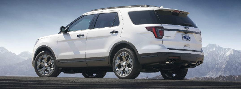 Profile view of 2018 Ford Explorer set against mountainous backdrop
