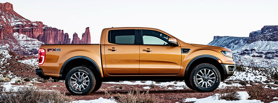 Profile view of 2019 Ford Ranger parked in front of mountainous backdrop