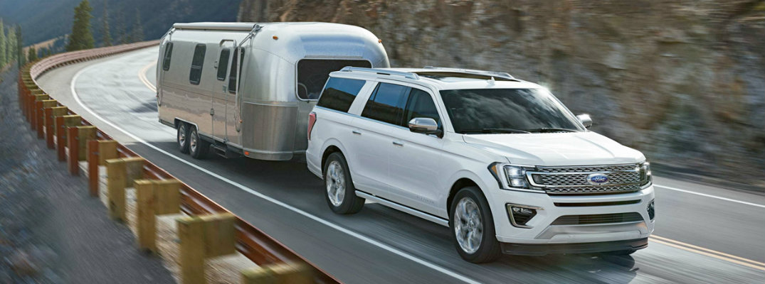 White 2018 Ford Expedition driving on mountain road