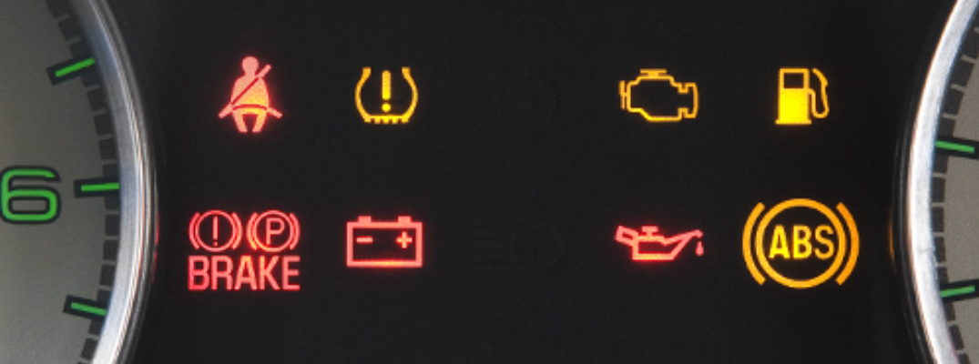 Various dashboard lights illuminated inside Ford vehicle