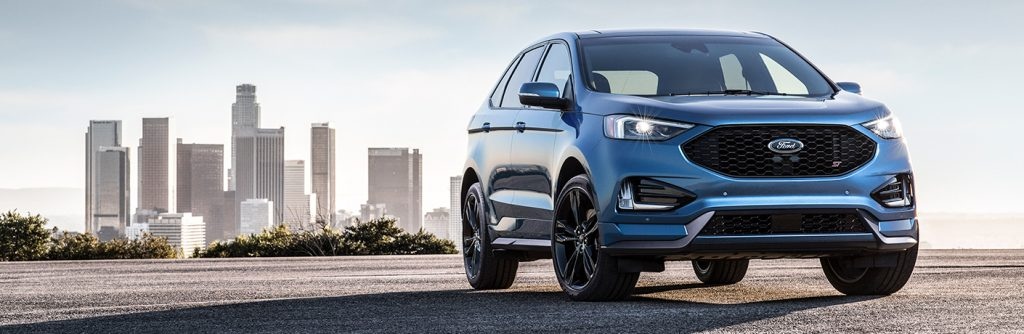 Blue 2019 Ford Edge positioned in front of city skyline