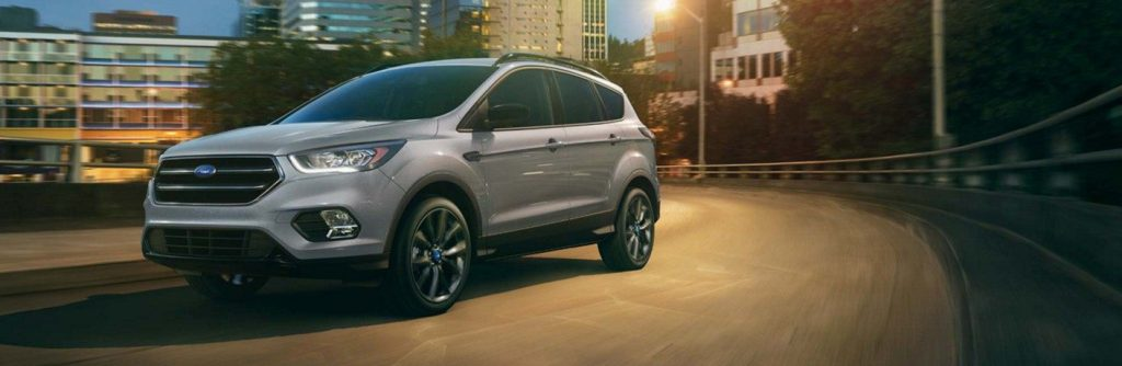 2019 Ford Escape driving on dark city street