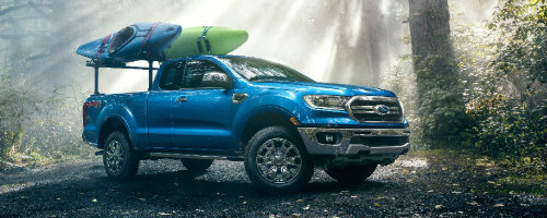 Profile view of blue 2019 Ford Ranger parked in forest