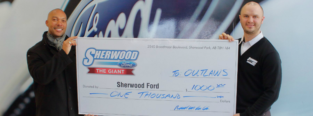 Sherwood Ford Presents Giant Check to Outlaws Lacrosse