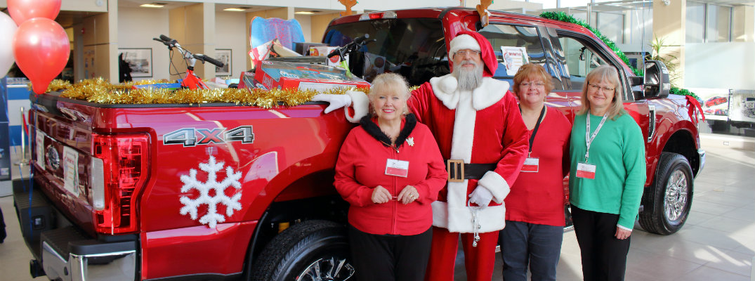 David from Sherwood Ford with Strathcona County Christmas Bureau members in front of 2018 F-150 pickup filled with gifts