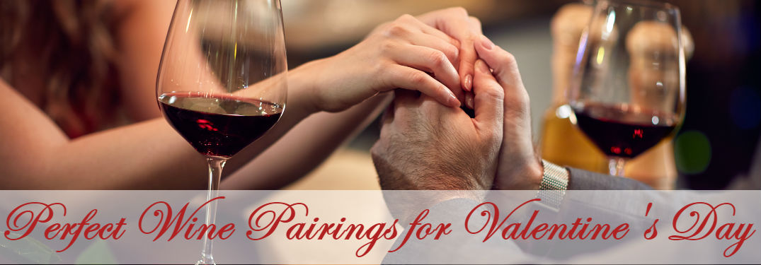 Perfect Wine Pairings for Valentine's Day with a couple holding hands next to their wine glasses