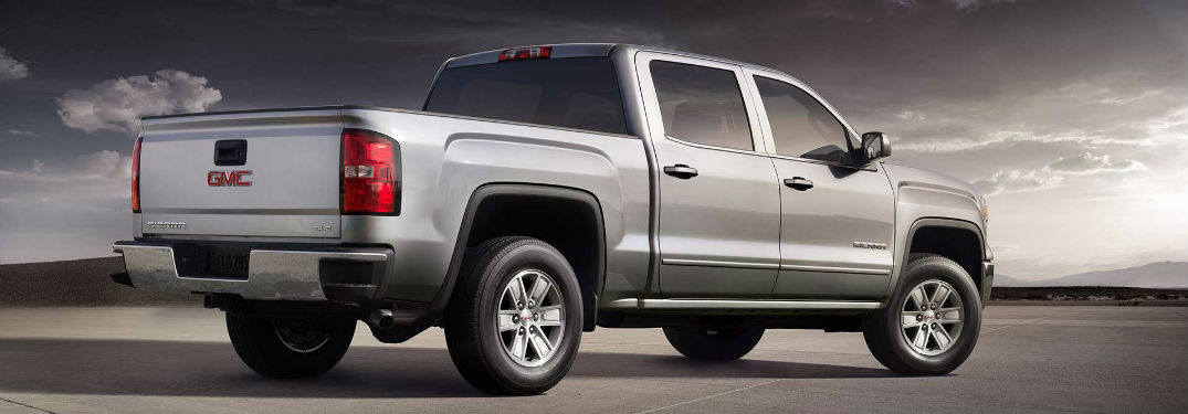 Passenger side exterior view of a gray 2018 GMC Sierra