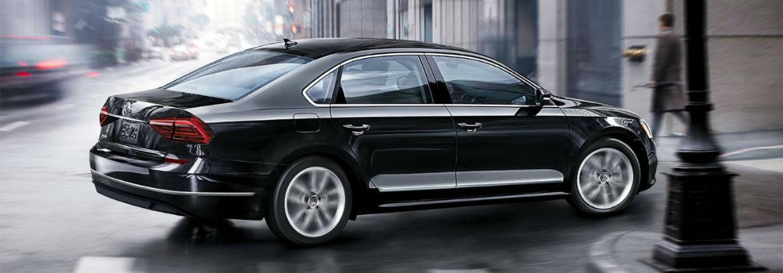 Passenger side exterior view of a black 2018 VW Passat