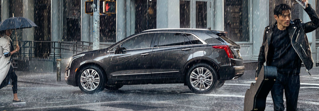 Driver's side exterior view of a gray 2018 Cadillac XT5
