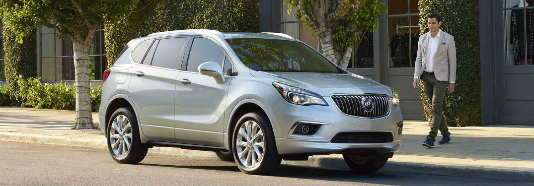 Passenger side exterior view of a gray 2018 Buick Envision