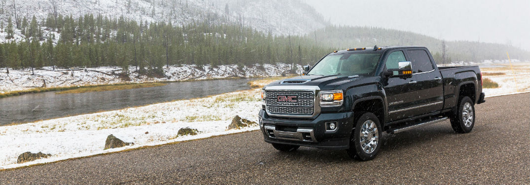 Driver side exterior view of a black 2018 GMC Sierra 2500 HD