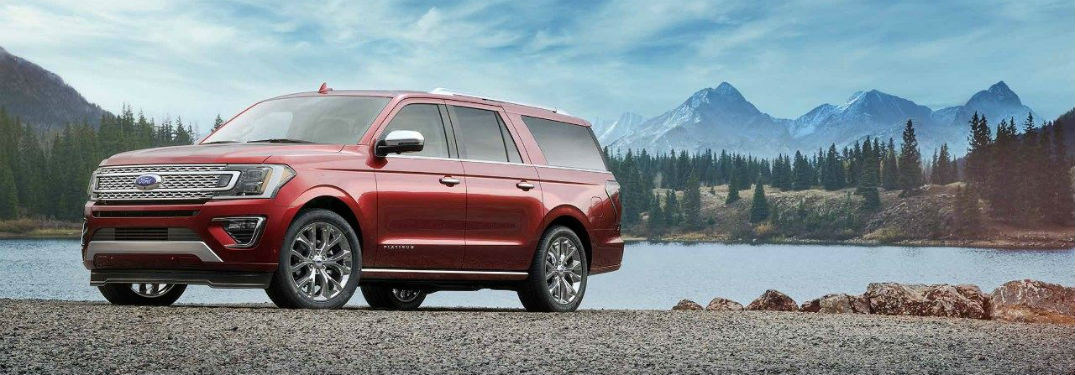 Driver side exterior view of a red 2018 Ford Expedition