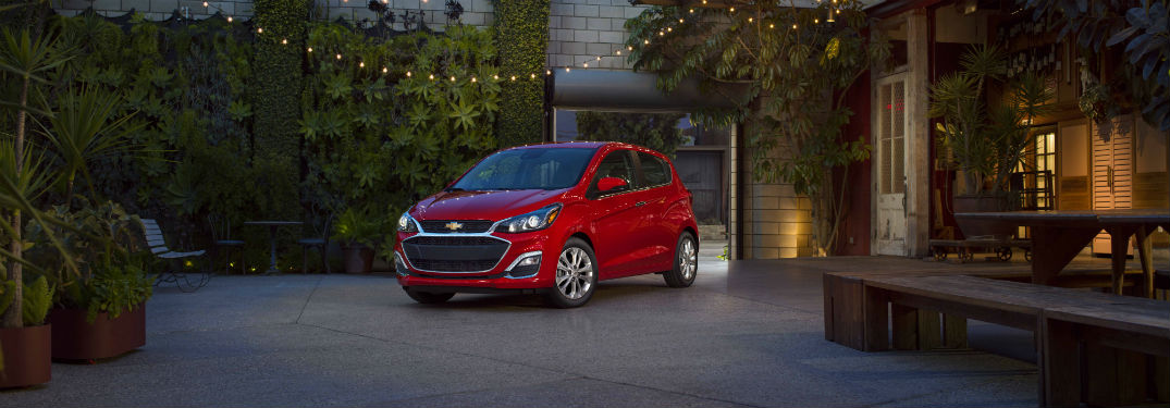 Driver side exterior view of a red 2019 Chevrolet Spark