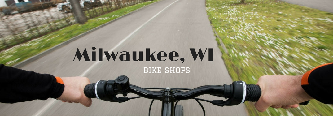 Milwaukee, WI Bike Shops, text on an image of a view from behind the handle bars of a bike on a paved trail