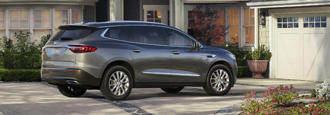 Passenger side exterior view of a gray 2019 Buick Enclave
